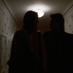 Mean Streets (1973) | Martin Scorsese production design | Martin Scorsese Films | Two silhouettes walking down white hallway with crucifix wallpaper