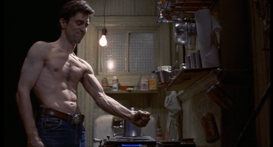 Taxi Driver (1976) | Martin Scorsese production design | Martin Scorsese Films | Robert DeNiro clenching fist over stove in kitchen