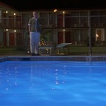 Bottle Rocket (1996) | Owen Wilson stands by pool outside motel | Director: Wes Anderson | Production Designer: David Wasco | Wes Anderson Production Design Porn