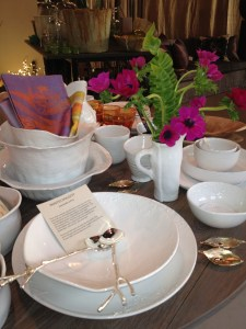 Montes Doggett tableware, silver sapling servers, linen napkins, dining in the garden