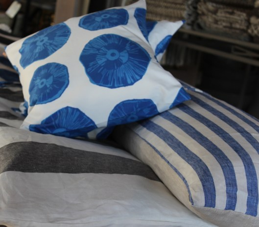 cotton pillows with very cool mushroom print - 3 sizes - designed, printed + finished locally awesome linen 'long pillow' in blue strip - fun for camp cots, loungers or the back of a sofa 'roll beds' - linen - throw it down on a sofa, lounge chair, over an adirondack...just about anything - washable!