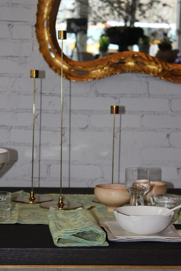 brass pin candlesticks , gold leaf mirror