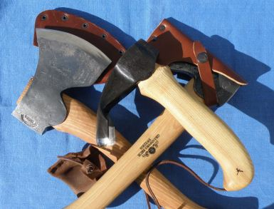 Two axes and an adze.Two axes and an adze.
