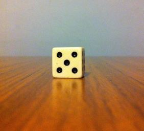 When the die is closer, look at it with just your right eye.