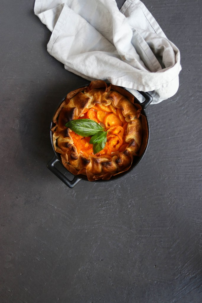 Photograph of tomato tart in baking pan