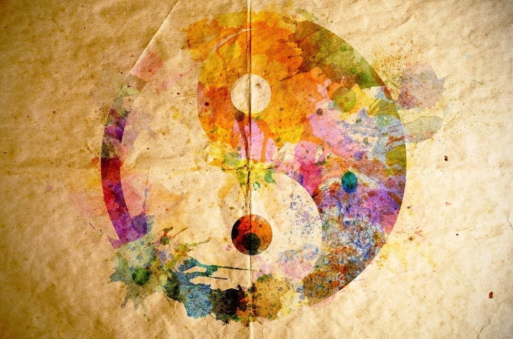 Watercolor yin yang symbol on old paper background