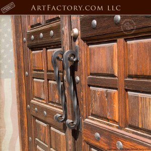 matching multi panel wood doors with twisted s iron door pulls