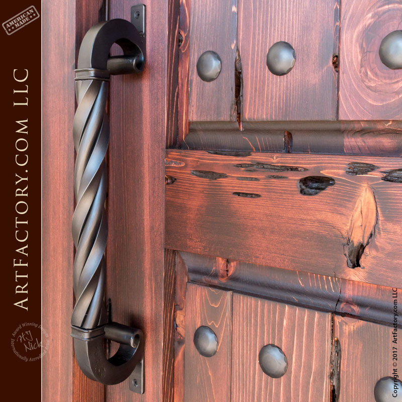 castle entrance door with c-shaped twisted door pull