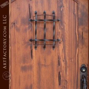 eyebrow arched speakeasy door with iron portal hatch grill