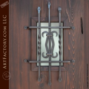 handcrafted double entrance doors with Spanish style door grill