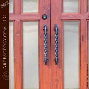 semi arched double glass panel doors with twisted c-shaped wrought iron door pulls