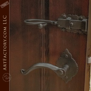hand carved mirror door with old world door handle