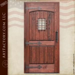 wooden castle gate with medieval dungeon door handle