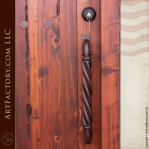 classic wooden speakeasy door with twisted wrought iron door pull