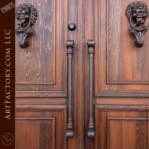 grand English castle entrance with c-scroll custom door pulls
