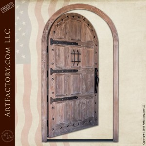 weathered wood arched door