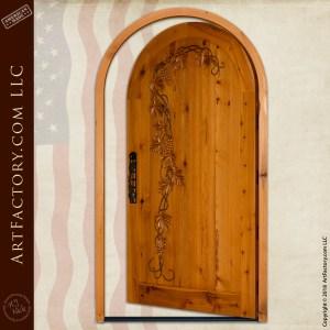 hand carved wine cellar door