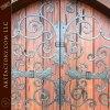 extravagant ornamental ironwork on wood door