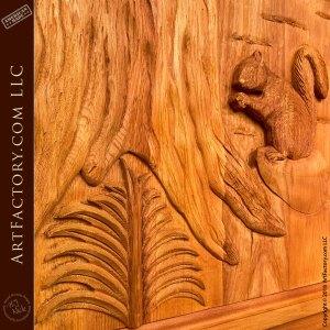 hand carved squirrel on wood door