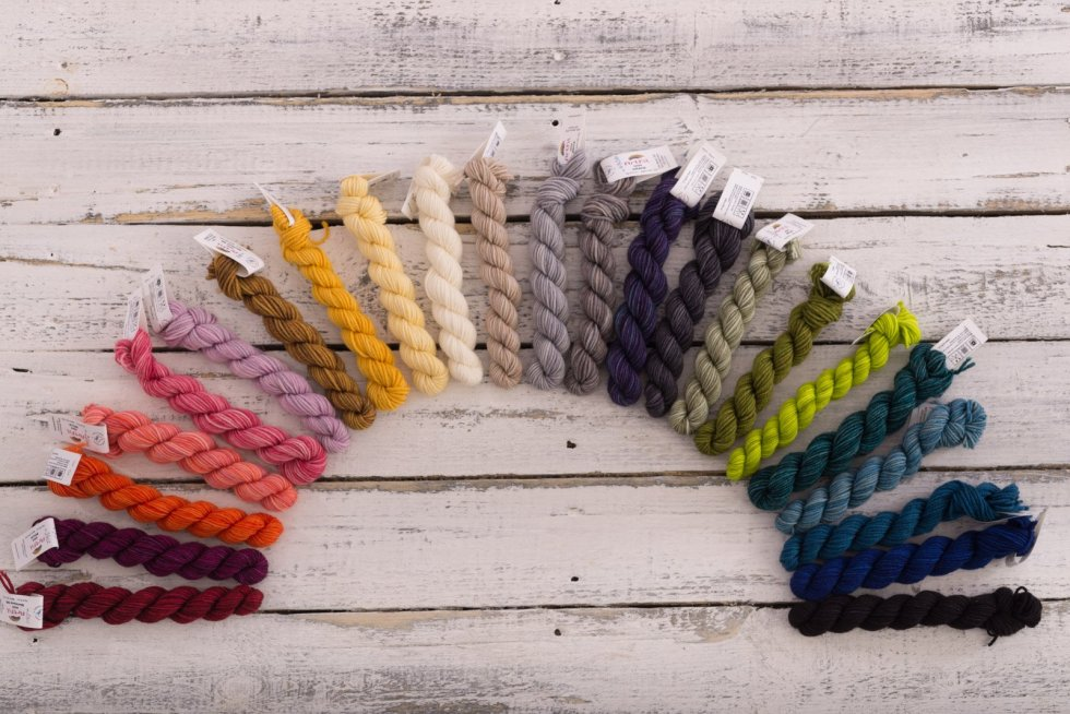 Mini-skeins of hand-dyed yarn in half cicrcle