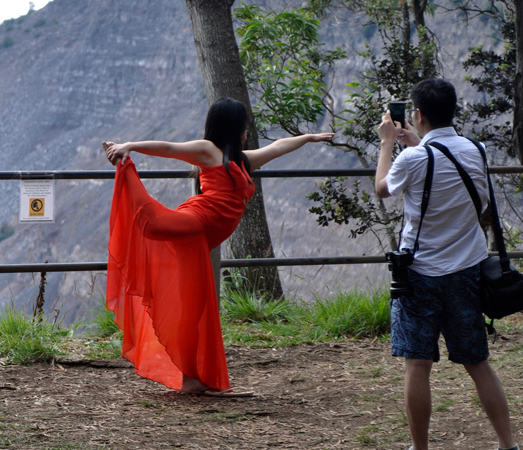 Artists/Dancer in Red Dress at Volcano National Park - photo by Glenn McClure