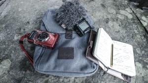 Camera and sound recorder, bag and notepad.