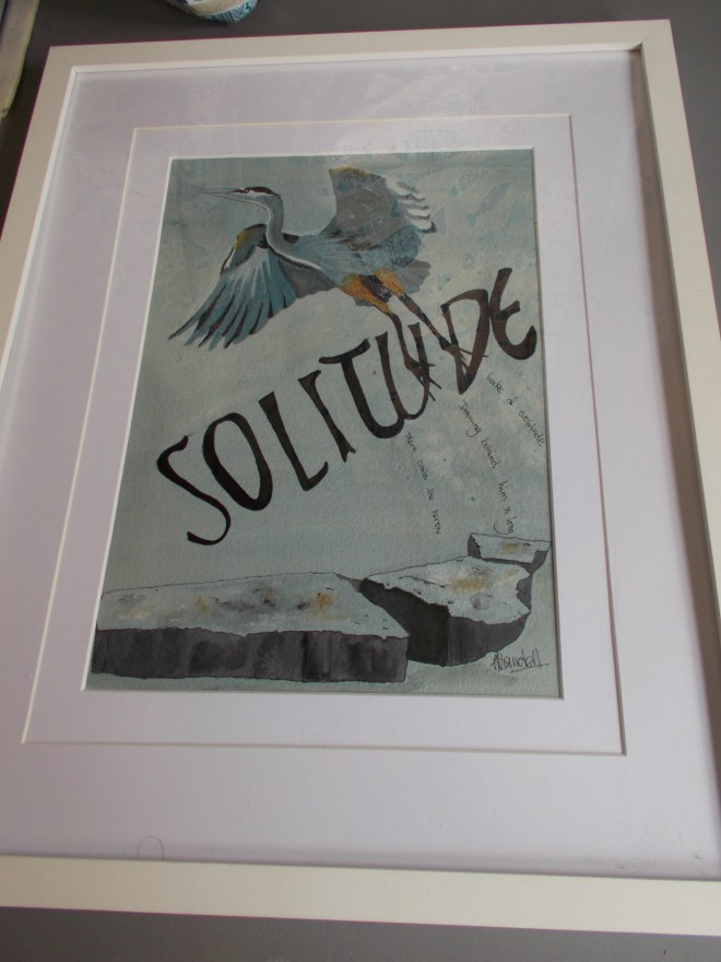 A framed painting of a heron with the words 'solitude'.