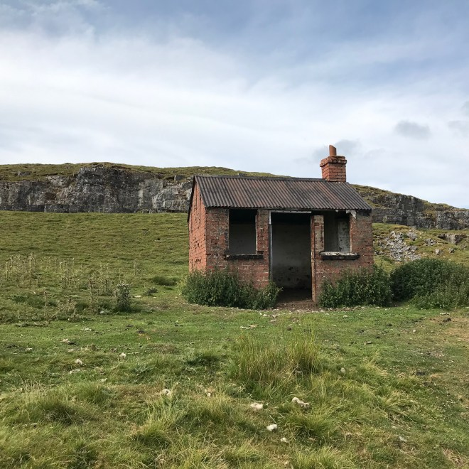 Small derelict house-like structure in rural landscape at High Cup.