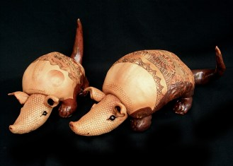 "Armadillos small - approx. 6""H x 9""W x 16""D large approx. 8""H x 12""W x 21""D"