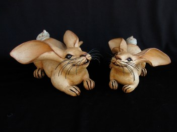 "Crouching Table Rabbits - approx. 6""H x 8""W x 10""L"