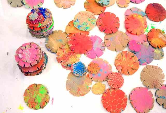 Colorful painted cardboard building discs for kids