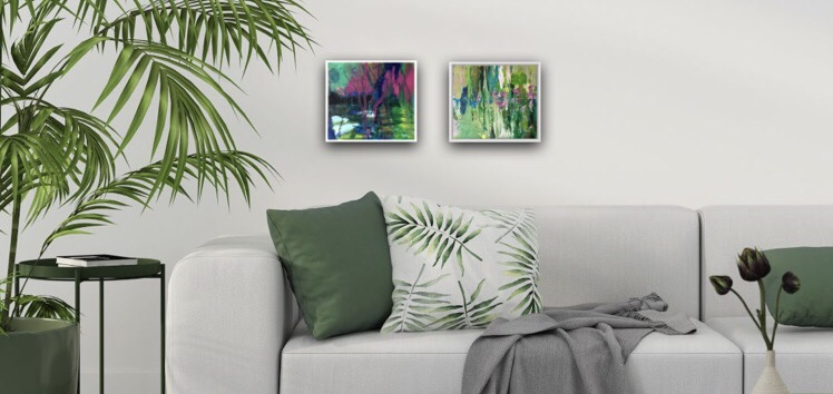 A couple of two small paintings highlighting a cosy sofa corner and giving it a very relaxing atmosphere.