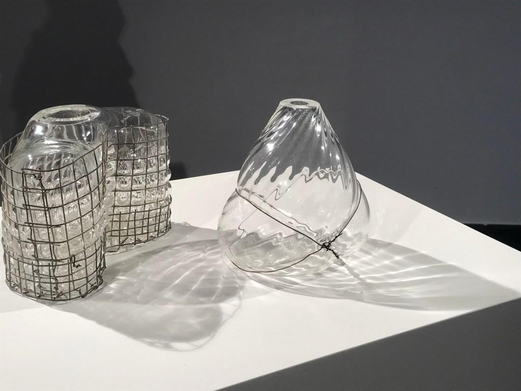 "3 transparent Glas Objekts blown into a Metal Cage"" by Gala Fernández"
