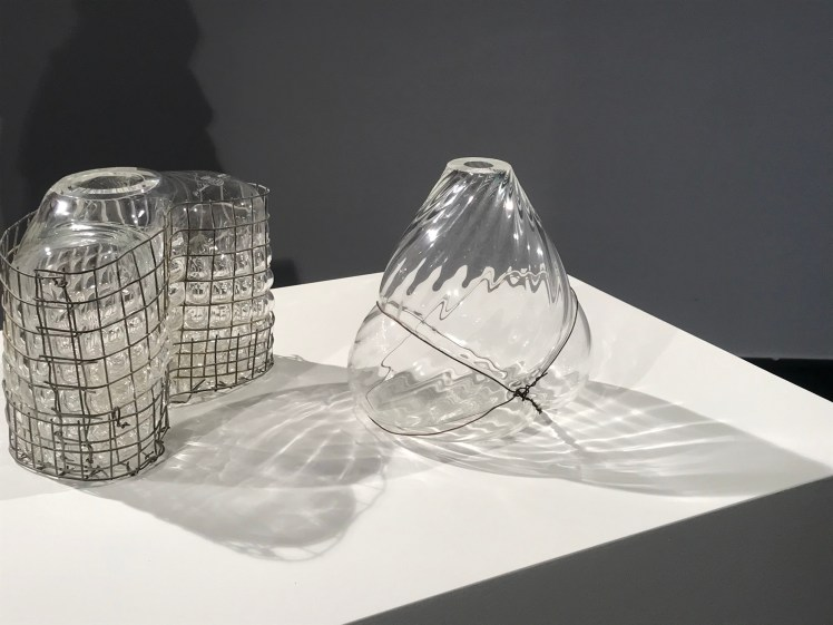 "3 transparent Glas Objekts blown into a Metal Cage"" by Gala Fernández"