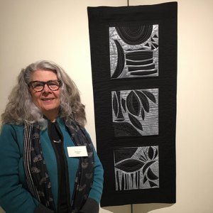 artist and textile artwork