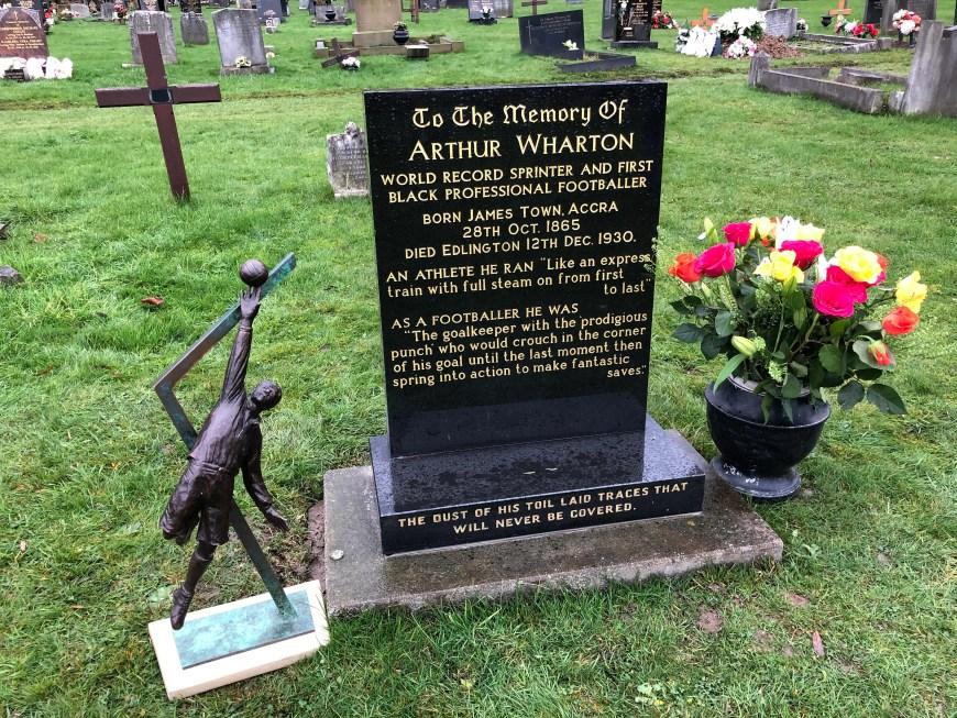 Arthur Wharton statue maquette, headstone and roses