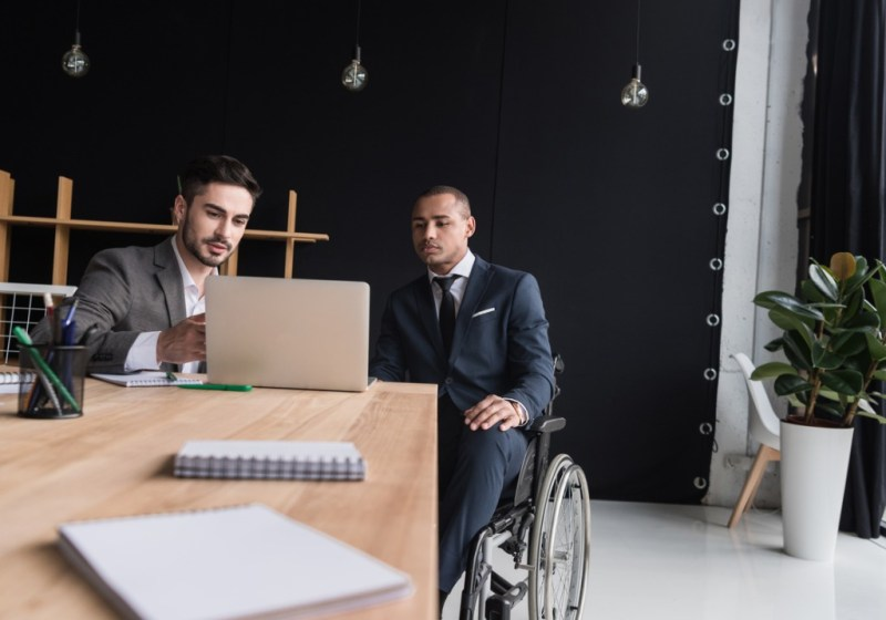 meeting of professionals with wheelchair