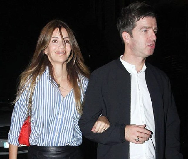 Oasis Noel Gallagher Shares A Tender Kiss With Wife Sara Macdonald On The Beach Details About Their Married Life