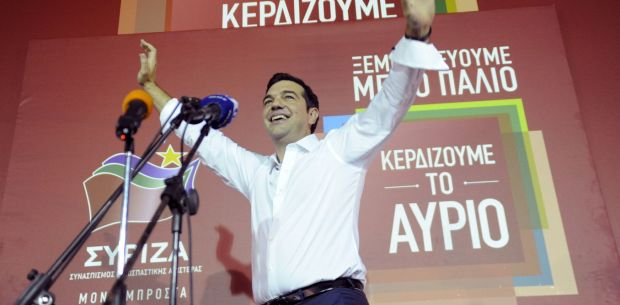 Greek prime minister and leader of leftist Syriza party Alexis Tsipras waves to supporters after winning the general election in Athens