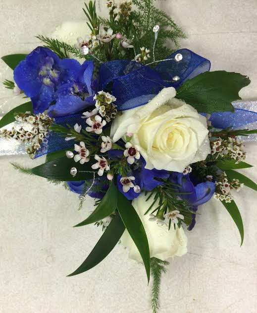 Blue delphinium and white roses.
