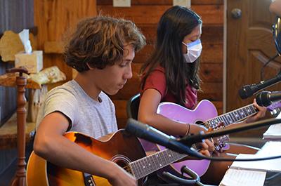Boy and girl guitar players