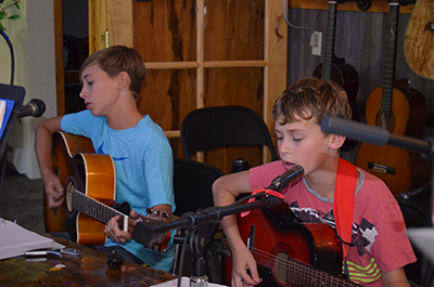 Brother guitar players