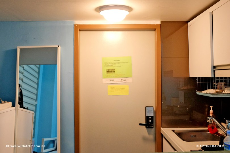 Those green and yellow papers posted on the front door contain Jay's house rules. / Photo by Ivan Angelo