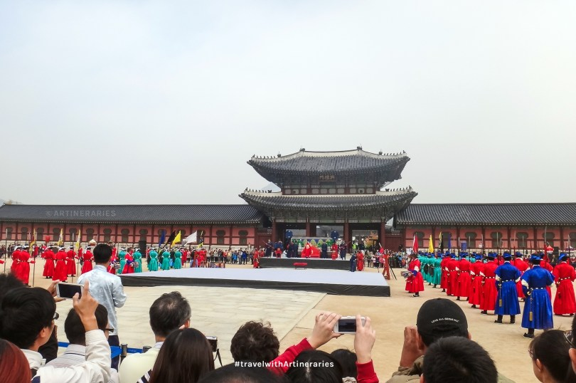 The changing of the guards, watched by hundreds of tourists