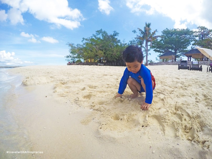 Lucas enjoying the sand at Virgin Island