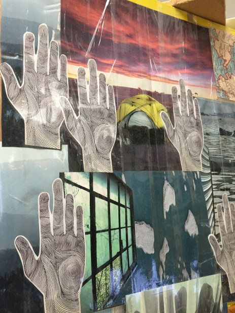 'hands up' collage on academic board at clarkston high school