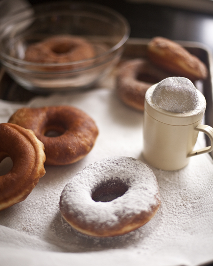 Adding powdered sugar to fresh, homemade doughnuts | Artisan Bread in Five Minutes a Day