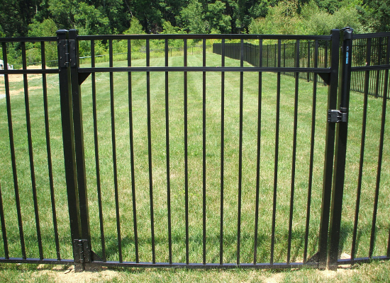 Black aluminum gate in a residential back yard
