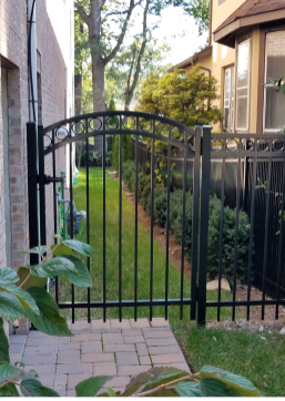 Residential aluminum single arch gate with circle embellishments