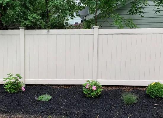 Tan Suburban style vinyl Privacy Fence